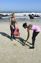 Two women cleaning the beach from plastic waste - ECPF00431