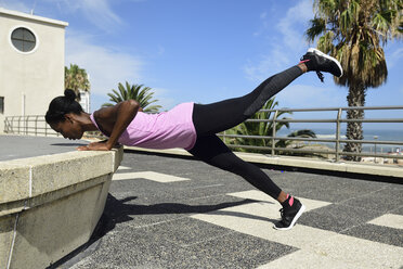 Sportive woman doing fitness exercises outdoors - ECPF00488