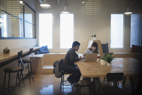 Business people working at laptops, planning and meeting in coworking space office - HEROF21168