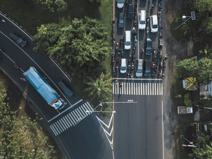 Indonesia, Bali, Sanur, Aerial view of cars, motorbikes and a truck on the road - KNTF02661