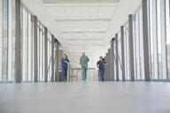 Surgeon and nurses running in hospital corridor - HEROF21751