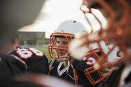 Teenage boy high school football player wearing helmet and sports uniform - HEROF21778