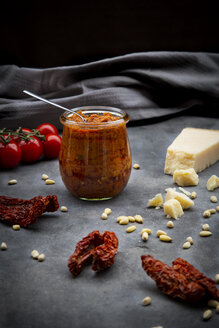 Glass of tomato pesto and ingredients - LVF07783