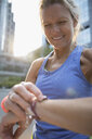Close up female runner checking smart watch - HEROF21897
