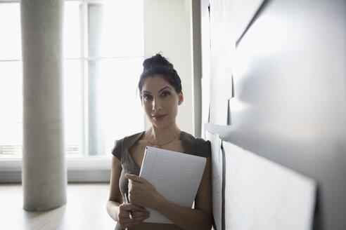 Portrait confident businesswoman brainstorming, preparing for meeting - HEROF22383