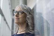 Portrait pensive businesswoman looking away - HEROF22422