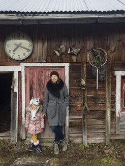 Finland, Kuopio, mother and daughter exploring the backyard - PSIF00229