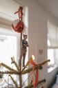 Businessman figurine hanging on a Christmas tree at home - FLAF00153