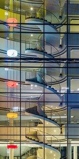 Germany, Stuttgart, spiral staircase at  modern office building - WDF05082
