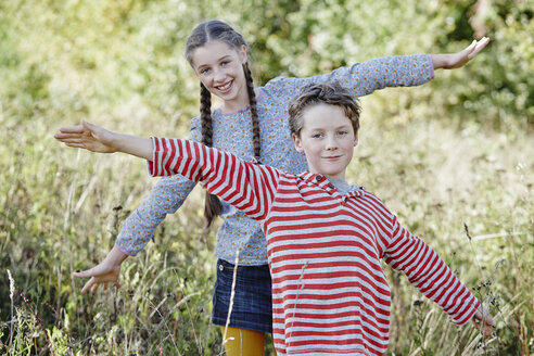Portrait of boy and his older sister playing in nature - RORF01747