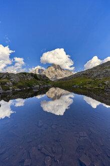 Italy, Veneto, Dolomites, Fiemme Mountains, Cimon della Pala, reflected in a small lake - LOMF00799