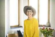 Portrait of happy stylish woman at home - SBOF01762