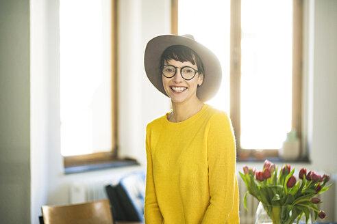 Portrait of happy stylish woman at home - SBOF01762