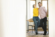 Happy couple having fun together in stylish apartment - SBOF01765