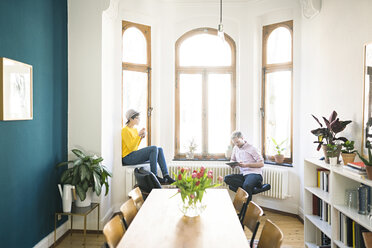 Couple relaxing in stylish apartment - SBOF01774