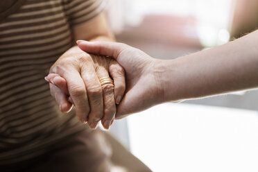 Cropped image of home caregiver holding hand of senior woman - MASF11160