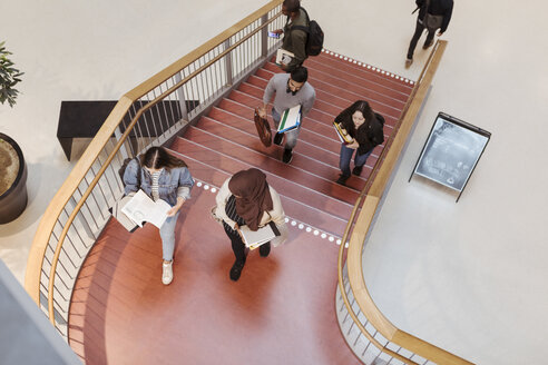 High angle view of students walking on steps in university - MASF11304