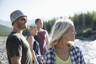 Couple friends hiking, looking away, sunny summer outdoors - HEROF22786