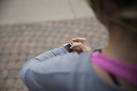 Female runner using smart watch - HEROF22915