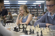 Middle school students playing chess in chess club - HEROF23083