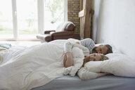 Serene couple sleeping on bed in bedroom - HEROF23269