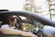 Smiling couple in car, enjoying road trip - HEROF23344