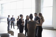 Business people networking at conference - HEROF23515