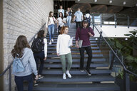 College students descending stairs on campus - HEROF23614