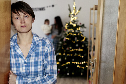 Same sex family celebrating Christmas at home - KMKF00762