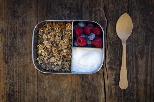 Breakfast box with granola, quinoa nuts, greek yogurt, blueberries and raspberries - LVF07794