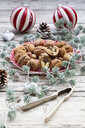 Walnuts on a plate with Christmas decoration - LVF07800
