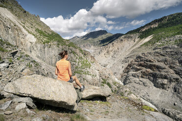 Switzerland, Valais, woman resting during a hiking trip in the mountains at Aletsch Glacier - DMOF00113