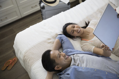 Couple taking selfie with digital tablet on bed - HEROF23770