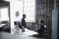 Creative business people talking in office - HEROF23959