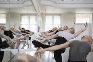 Ballet dancers practicing at barre in dance studio - HEROF24124