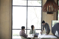 Architects working in conference room meeting - HEROF24205