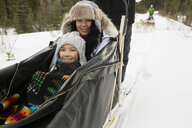 Portrait of mother and daughter in dogsled - HEROF24223