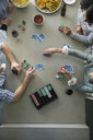 Overhead view of friends playing poker - HEROF24316
