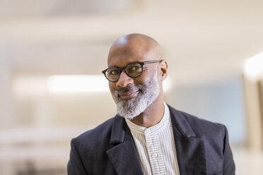 Portrait of bald mature businessman with grey beard wearing glasses - FMKF05402