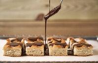 Garnishing homemade cake with chocolate - EPF00560