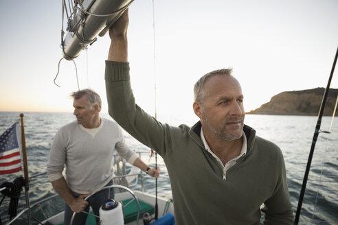Men fishing on sailboat - HEROF24462