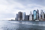Scenic view of East River and city against cloudy sky - ASTF02846