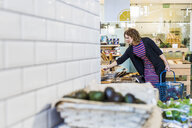 Young woman buying bread in supermarket - ASTF03206