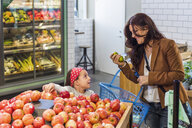 Happy mother and daughter shopping fruits in supermarket - ASTF03212