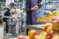 People shopping fruits while standing in supermarket - ASTF03326