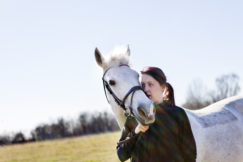 Loving woman and horse on sunny day - ASTF03362