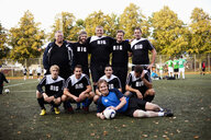 Portrait of happy soccer team at field - ASTF03611