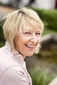 Close-up portrait of happy senior woman - ASTF03743