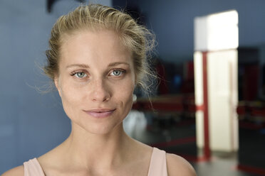 Portrait of confident young blond woman in a gym - ECPF00525