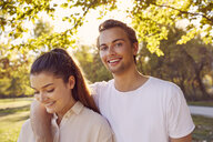 Portrait of happy young couple in a park - JHAF00033